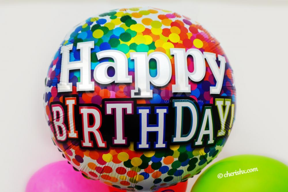 A Vibrant Happy Birthday Foil Balloon.