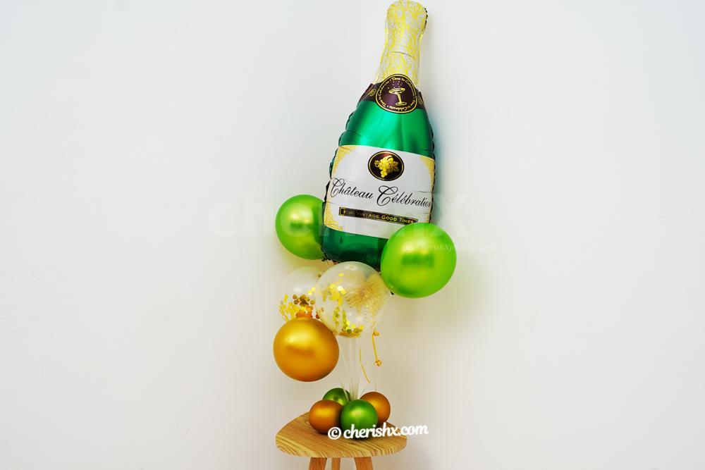 Green and Golden Confetti balloons put together with Champagne bottle balloon to give you the whole bunch.