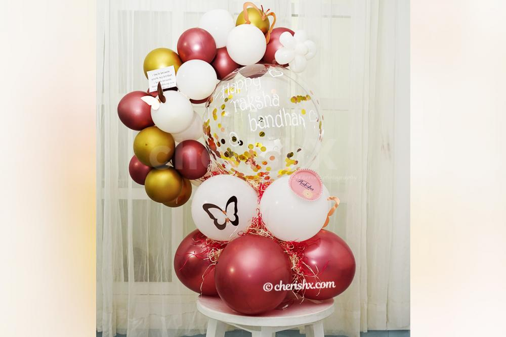 A message attached with the Gold & Rose Gold Rakhi Balloon Bouquet.