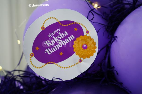 A Raksha Bandhan message attached with the Best SIS Lavender Balloon Bouquet
