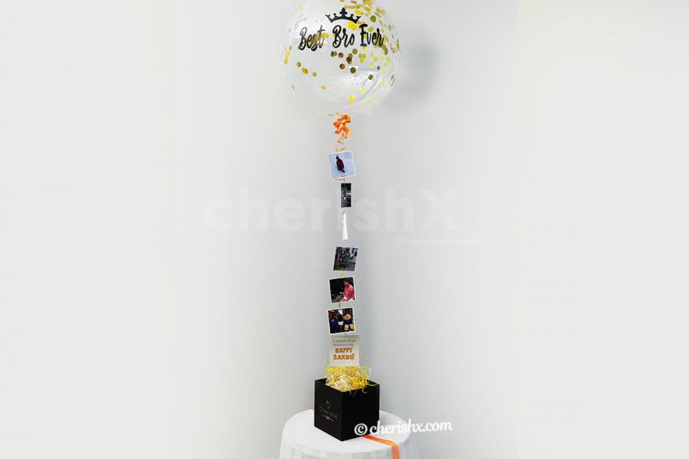 The surprising bucket holds six photos under the helium balloon for you to surprise your brother.