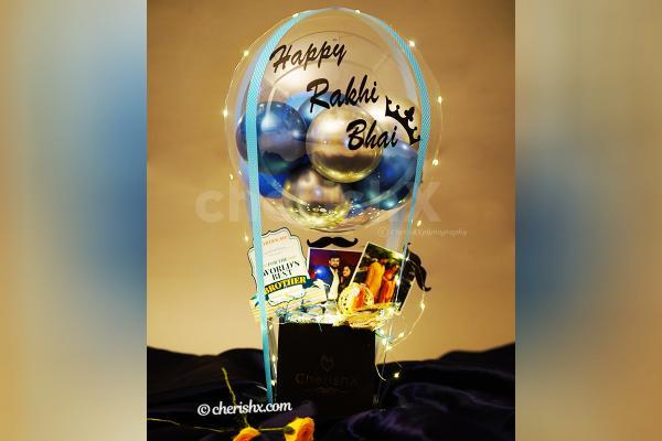 An elegant blue happy Rakhi Bhai Balloon Bucket.