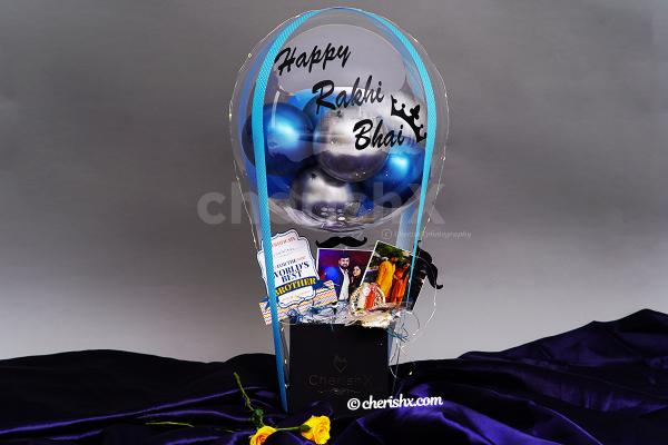 A bucket filled with photos, chocolates and balloons to gift your brother.