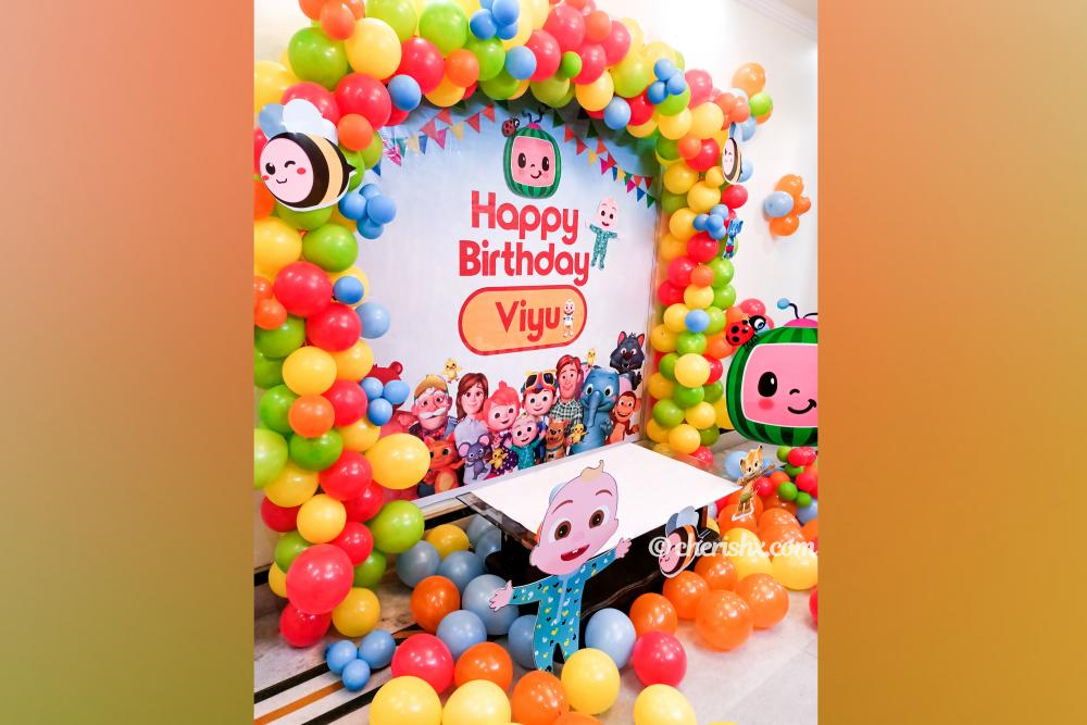 2. CherishX's Cocomelon Themed Kid's Birthday Decor includes colourful balloons and themed cut-outs