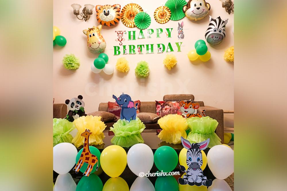 CherishX's Jungle Themed Birthday Decor includes wall and table decor with themed cut-outs.