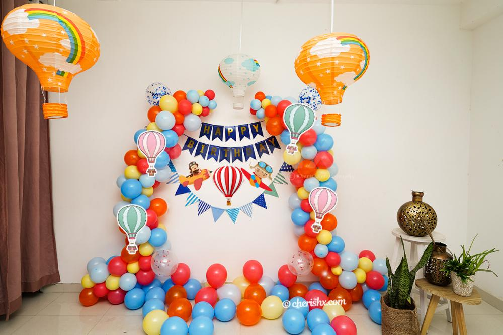 Surprise your kid with CherishX's Hot Air Themed Birthday Decors.