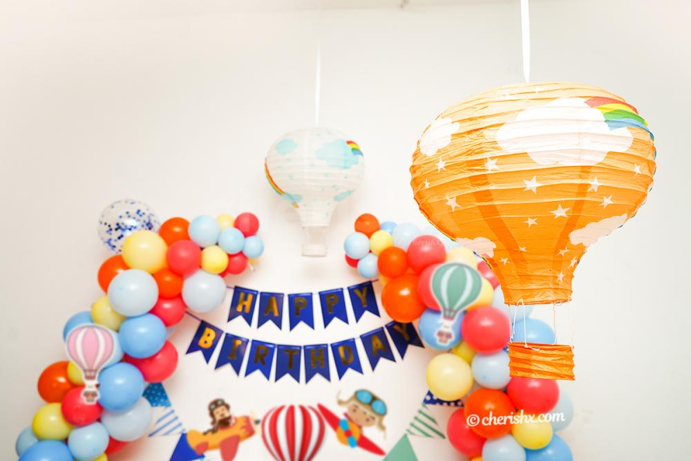 Arc of Colourful Balloons and parachute paper cut-out.