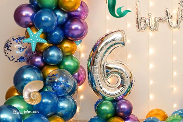 Happy birthday silver letter foil balloon.