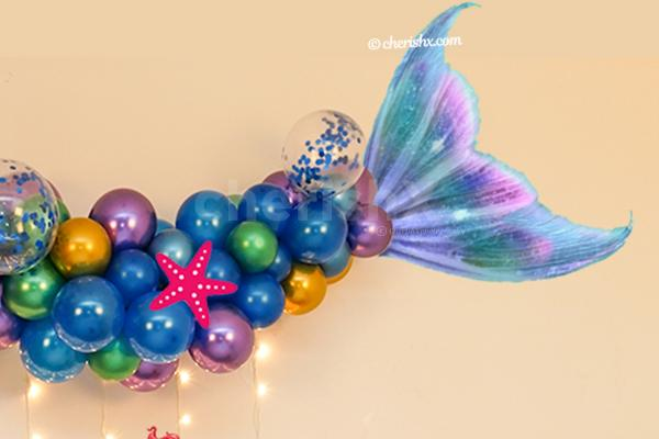A Classy Mermaid Theme Wall Decoration for your kid's birthday.